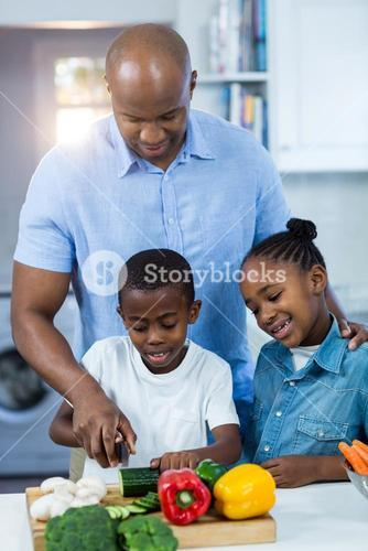 Father preparing food with their children