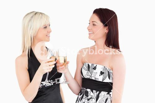 Beautiful women in beautiful dresses toasting with champaign
