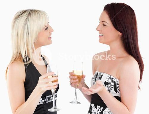 Gorgeous welldressed women drinking champaign