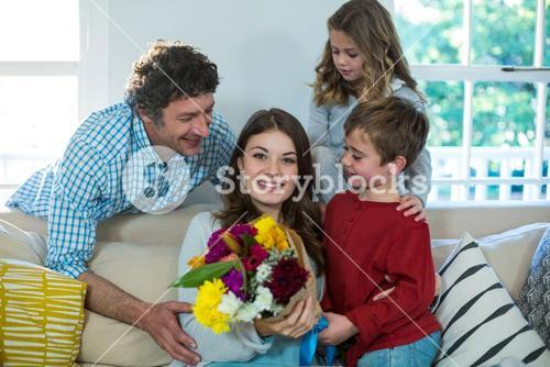 Happy family with flower bouquet