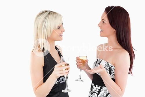 Cute welldressed women drinking champaign