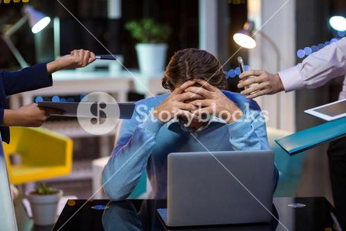 Frustrated businessman sitting in office