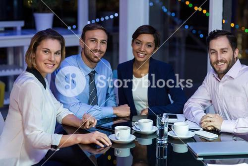 Businesspeople taking tea break
