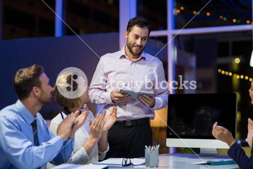 Businesspeople applauding on their colleagues presentation