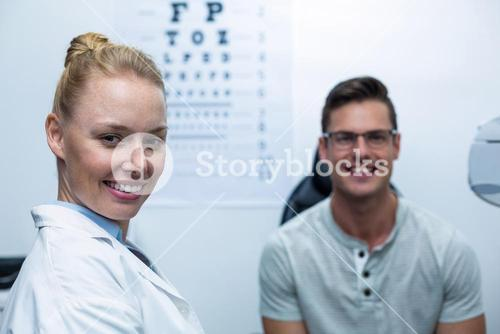 Portrait of female optometrist in ophthalmology clinic