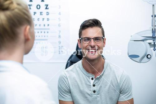 Smiling patient in ophthalmology clinic
