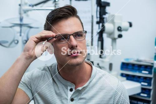 Close-up of patient trying spectacles
