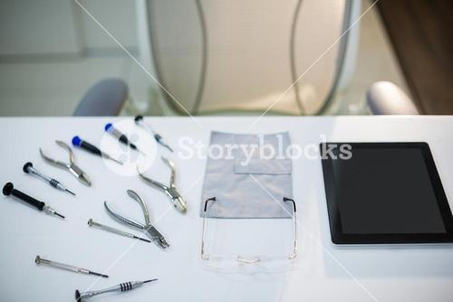 Work tools with spectacles and digital tablet on table