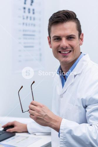 Optometrist working in ophthalmology clinic