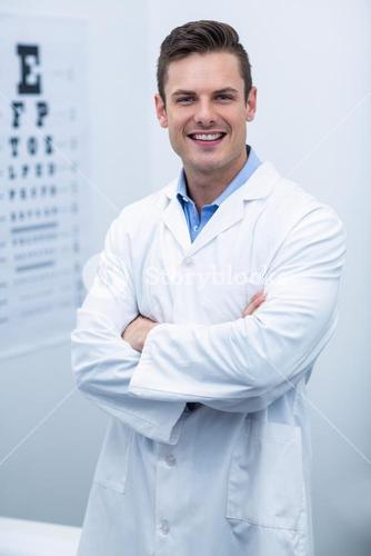 Optometrist standing in ophthalmology clinic