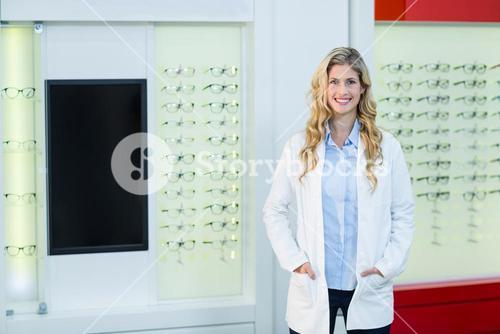 Beautiful optometrist standing in ophthalmology clinic