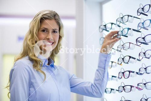 Female customer selecting spectacles
