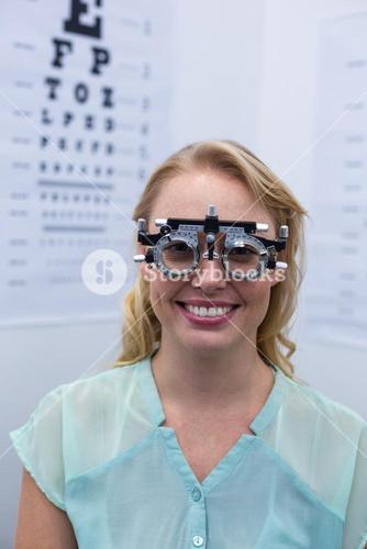 Female patient looking through messbrille during eye examination