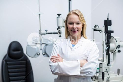 Female optometrist standing in ophthalmology clinic