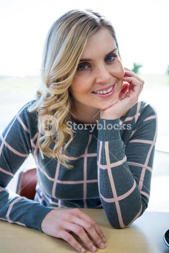 Smiling woman sitting in cafeteria