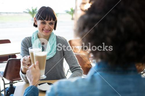 Couple toasting glass of cold coffee