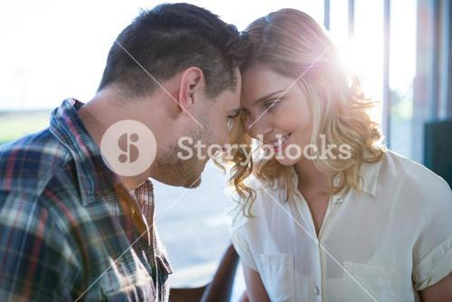 Couple looking face to face in cafeteria