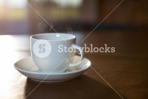 Coffee cup with saucer on a table