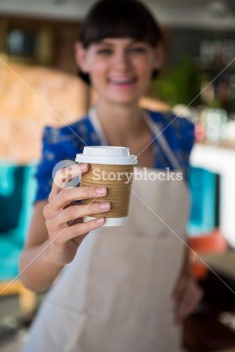 Waitress offering a cup of coffee