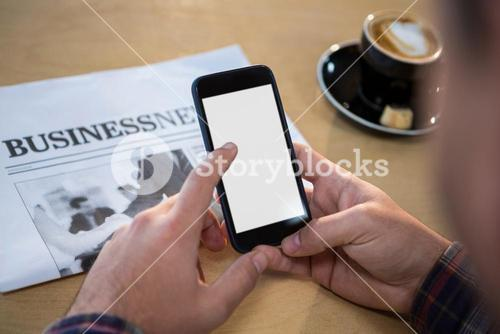 Hands of a man using mobile phone