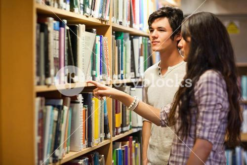 Students choosing a book