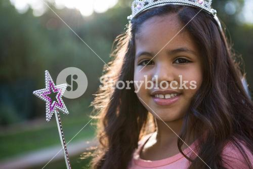 Portrait of girl in tiara and wand