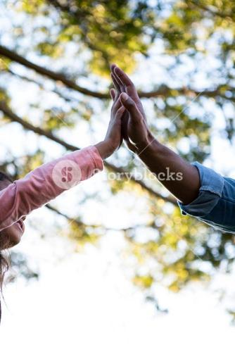 Father giving high five to his daughter