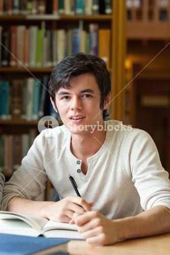Handsome student reviewing his notes