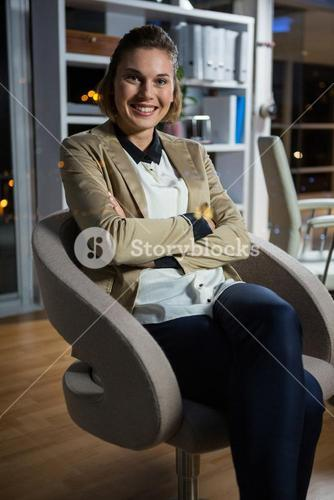 Portrait of businesswoman sitting on chair
