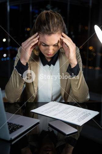 Frustrated businesswoman working in office