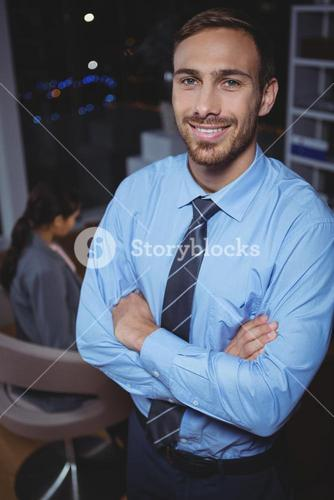 Business executive standing with arms crossed