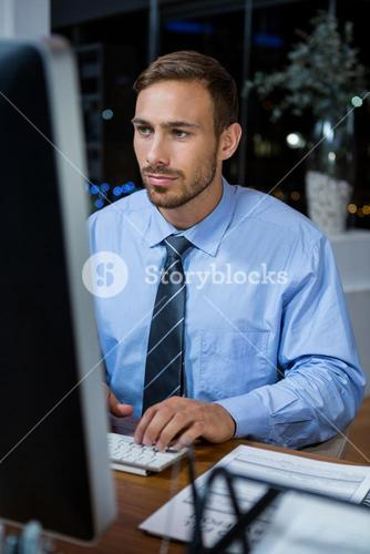 Business executive working on computer in office