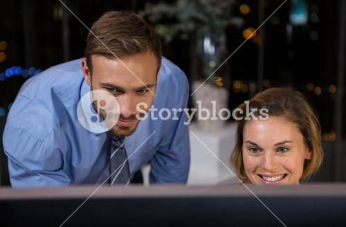 Business executives working on computer