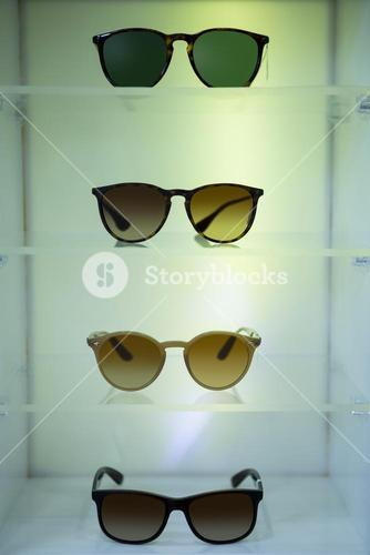 Close-up of various sunglasses on display