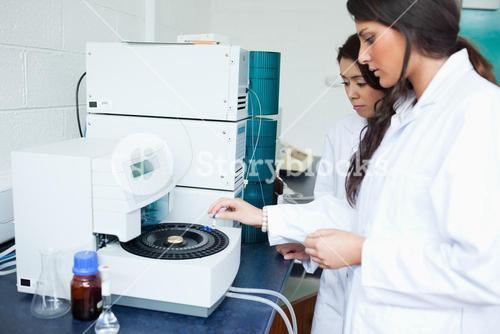 Students using a centrifuge