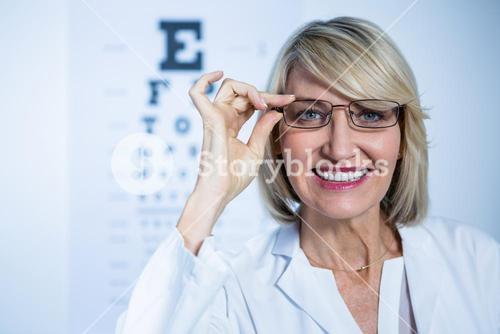 Smiling female optometrist wearing spectacles