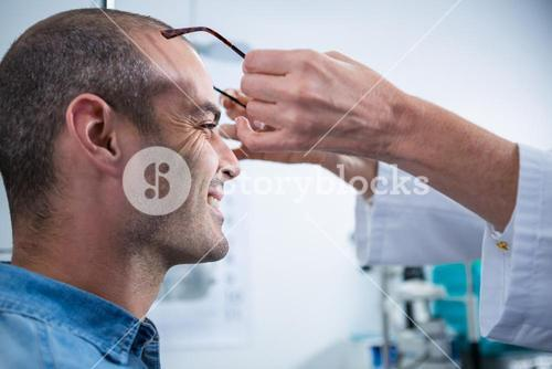 Female optometrist prescribing spectacles to patient