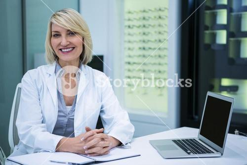 Female optometrist sitting in ophthalmology clinic