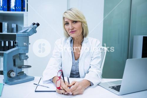 Optometrist sitting in ophthalmology clinic