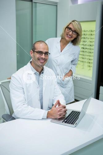 Smiling optometrists in ophthalmology clinic