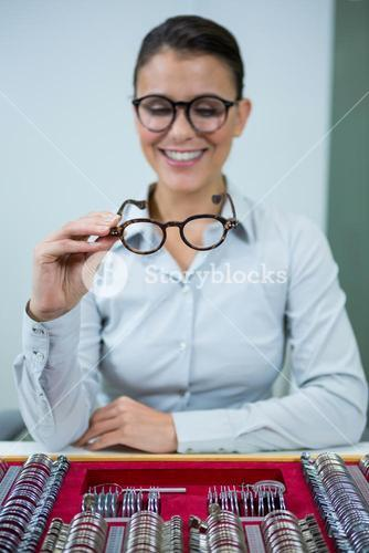 Optician looking at spectacles