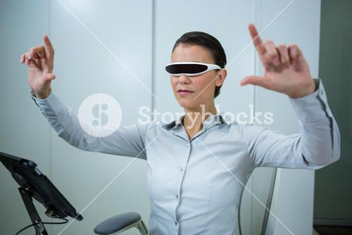 Woman using virtual video glasses