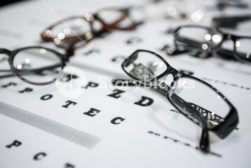 Close-up of various spectacles on eye chart