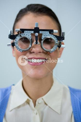 Female patient wearing messbrille during eye examination