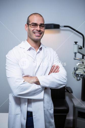 Portrait of male optometrist with arms crossed