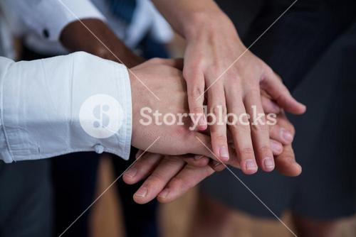 Close-up of business people with hand stack