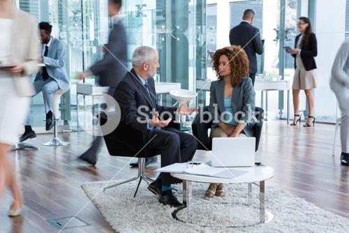 Business executive interacting in office