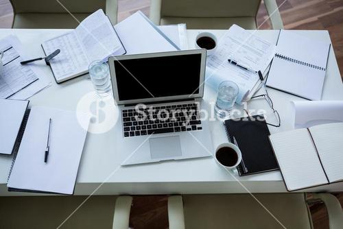 Laptop, organizer and tea on table