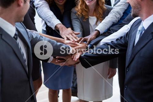 Businesspeople with hand stacked