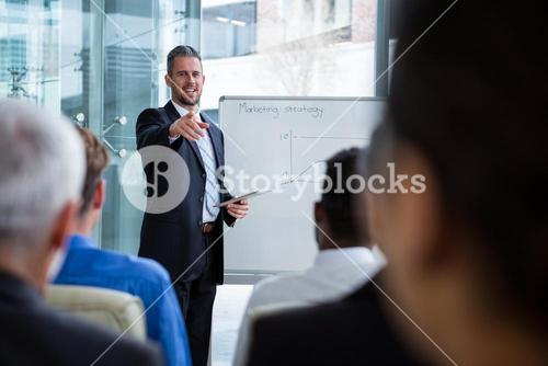 Businessman interacting with co-worker
